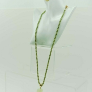 Long necklace with gold scallop shell designer Axelles, buy online, kopen, kupit.